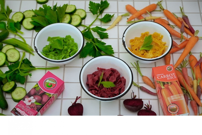 3 bolws with green orang and beetroot pulled noodles